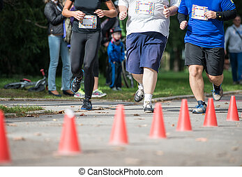 Group of unrecognizable runners outdoors. Long distance...