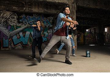 Group of urban dancers performing