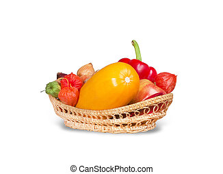 Group of various fruits and vegetables in wicker basket