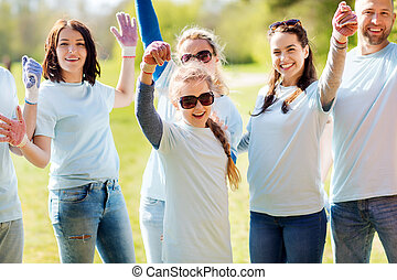 group of volunteers celebrating success in park