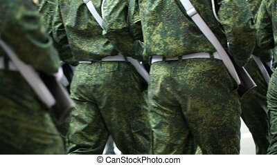 Group of walking soldiers - soldiers marching training in...