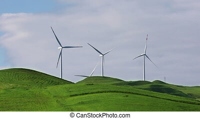 Group of wind turbines on spring field on a sunny day