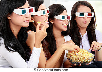 watching movie wearing 3d glasses