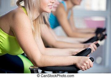 Group of women doing cycling cardio training