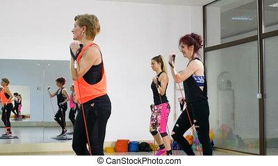 Group of women doing healthy lifestyle aerobics training...