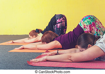 Group of women practicing yoga in class