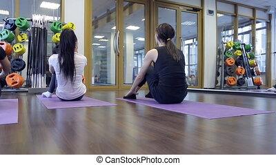 Group of women shaking press inside fitness yoga exercise....