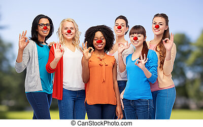 group of women showing ok sign at red nose day