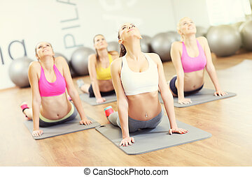 Group of women stretching in gym