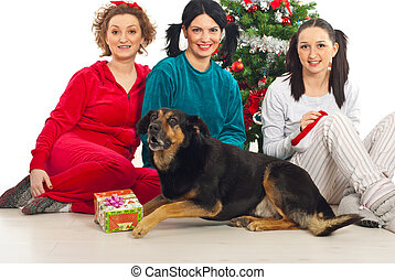 Group of women with dog near Xmas tree