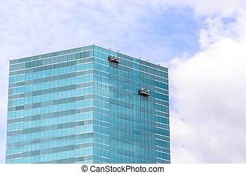 Group of Workers Cleaning Windows Service on High Rise Building.