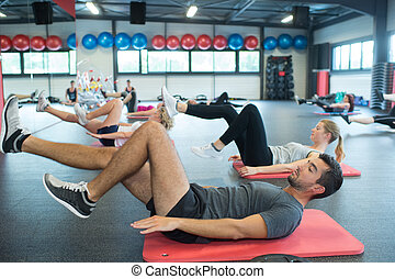 group of young adults having fitness class
