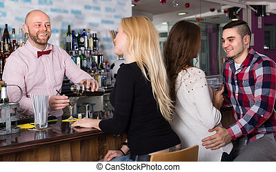 Group of young adults in bar