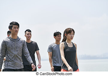 group of young asian adults walking outdoors
