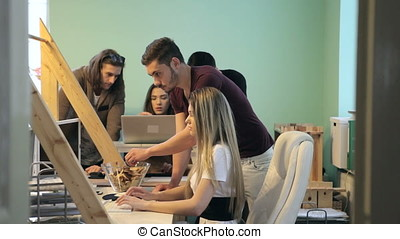 Group of young business people working in office