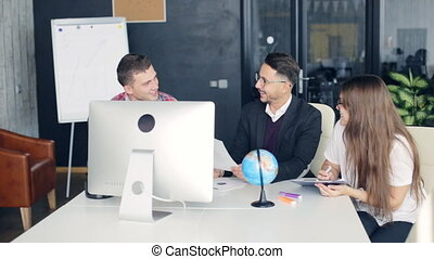 Group of young business people working together in creative office