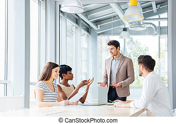 Group of young business people working together in office