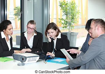 Group of young business professionals in a meeting