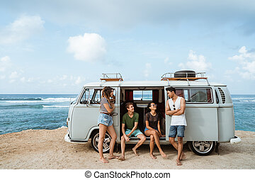 Group of young cheerful and smiling while leaning at retro style