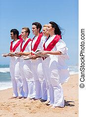 church choir singing on beach