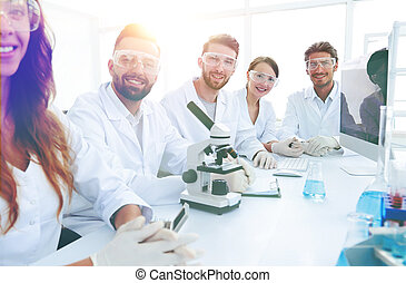 Group of young clinicians experimentation in research laboratory. development of technology