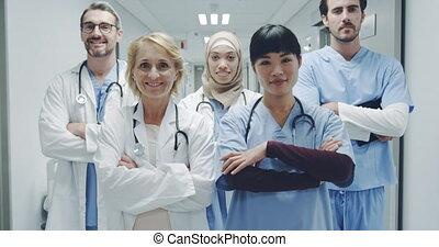 Group of young doctors standing in corridor 4k