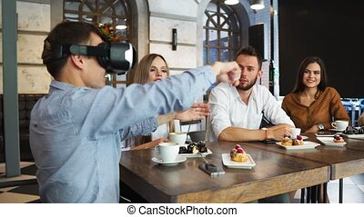 Group of young entrepreneurs in a meeting with VR headset