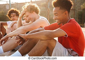 Group of young excited multiethnic men basketball players ...