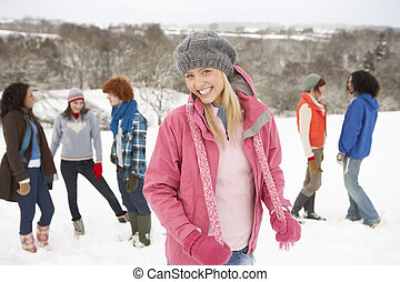 Group Of Young Friends Having Fun In Snowy Landscape