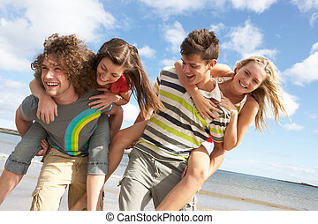 Group Of Young Friends Having Fun On Summer Beach Together