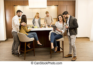 Group of young friends in modern kitchen