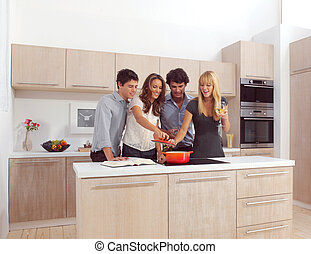 Group Of Young Friends Preparing Breakfast
