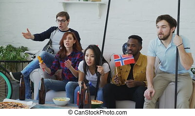 Group of young friends sports fans with Norwegian national...