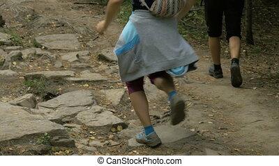 group of young girls run from mountai