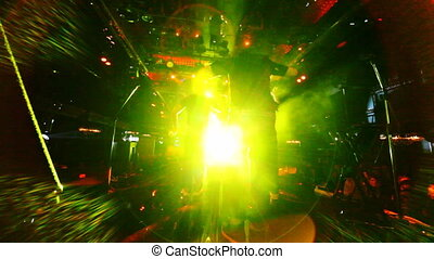 group of young guys dancing hip-hop in nightclub, view from...