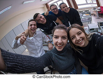 young happy students doing selfie picture