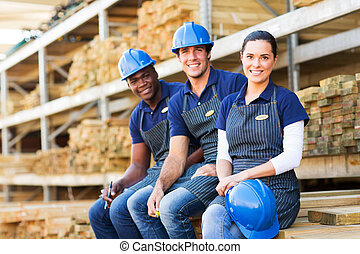 group of young hardware store co-workers - group of cheerful...