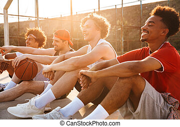 Group of young laughing multiethnic men