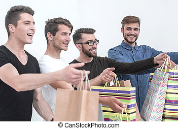 group of young men with shopping bags