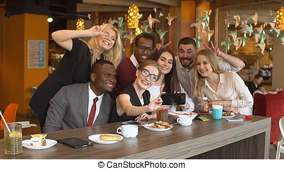 Group of Young Mixed race People in Coffee Shop.