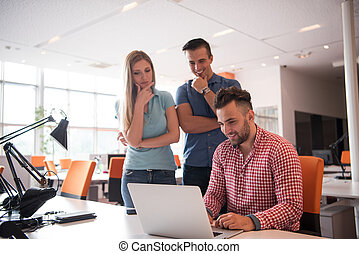 Group of young people employee workers with computer