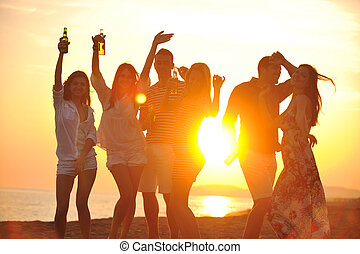 Group of young people enjoy summer party at the beach on...