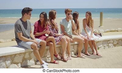 Group of young people enjoying a summer vacation