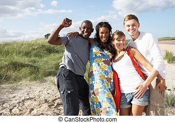 Group Of Young People Having Fun On Beach Together