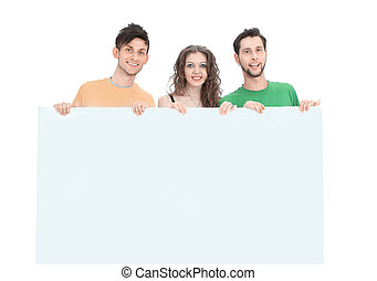 group of young people holding a large blank poster