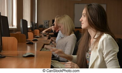 Group of young people in a computer classroom