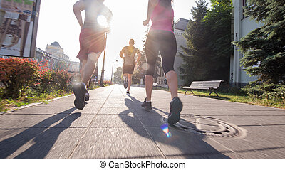 group of young people jogging in the city