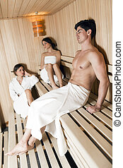 Group of young people relaxing in a sauna