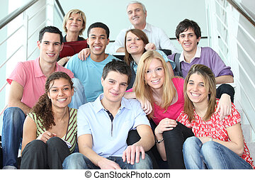 Group of young people sitting on stairs