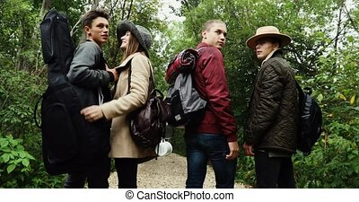 Group of young people standing in forest